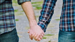 gay_couple_holding_hands_istock_77025100